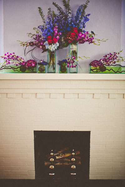 wedding flower arrangement on fireplace mantle