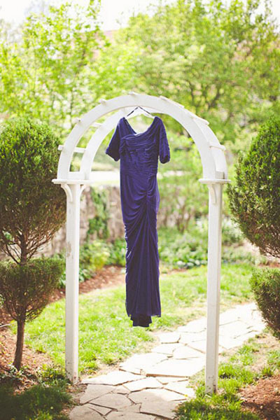 purple wedding dress hanging outside