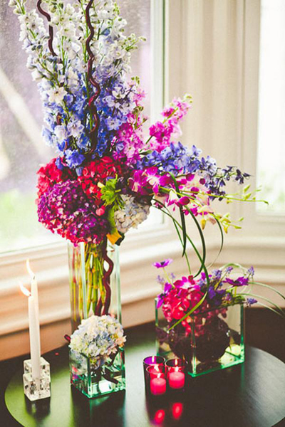blue, purple and pink wedding flower arrangements