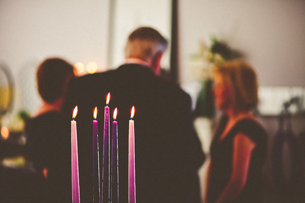 purple candles at wedding
