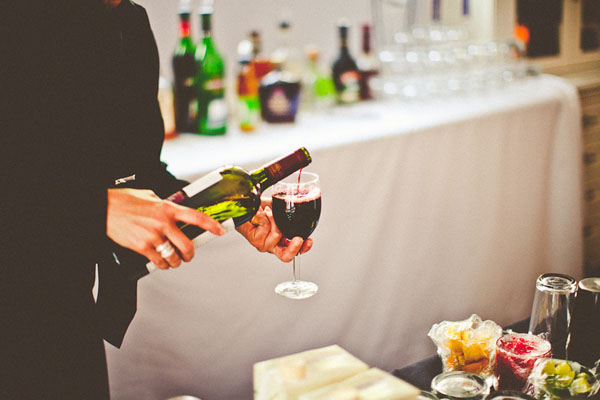 bartender pouring red wine