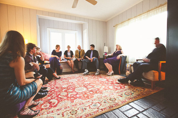 wedding guests gathered in living room