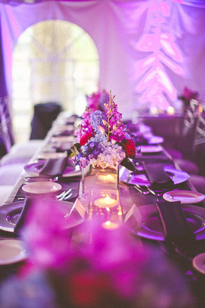 purple flower arrangements on reception tables