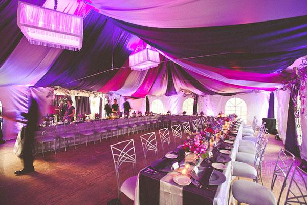 purple fabric draped in wedding tent