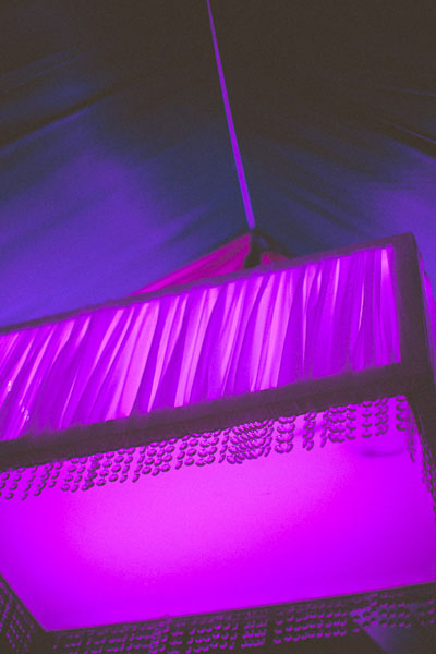 purple light in wedding tent