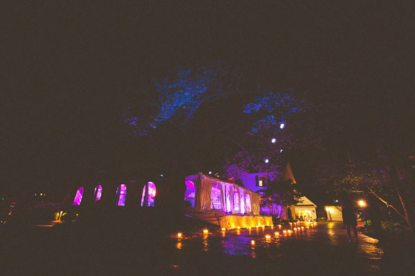purple lit wedding tent at night