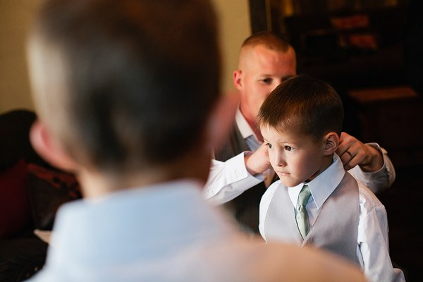 ring bearer getting dressed