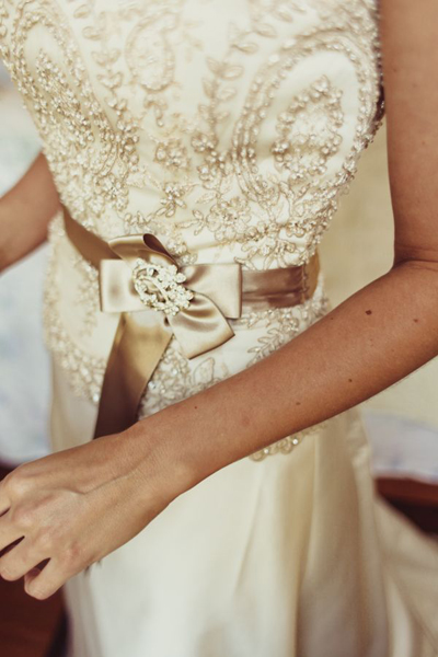 beaded wedding gown with brown sash