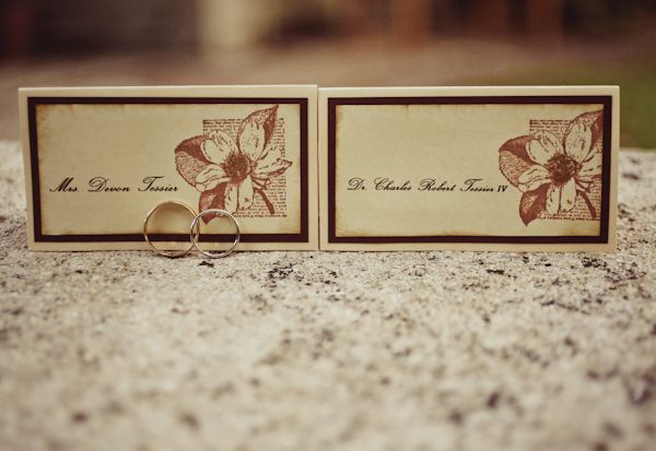 wedding rings next to placecards