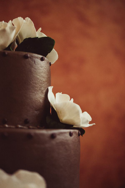 chocolate wedding cake with white flowers