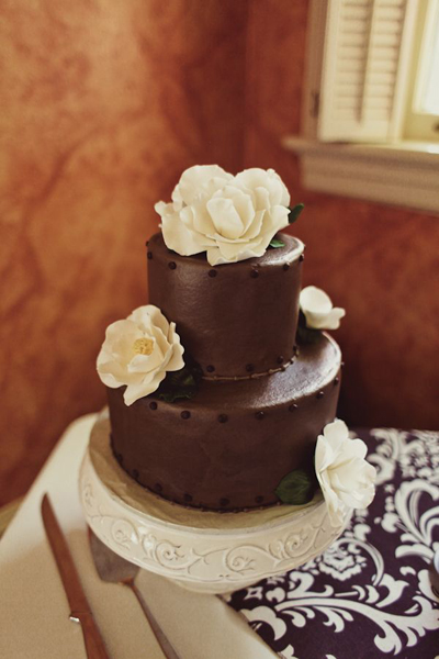 chocolate wedding cake with white sugar roses