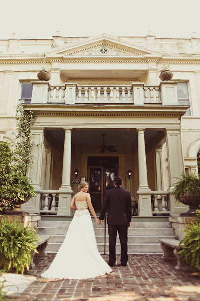 bride and groom in front of grand Savannah house