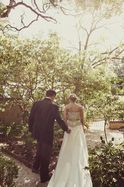 bride and groom walking in Savannah garden