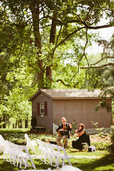 guitarist and violinist at outdoor wedding ceremony