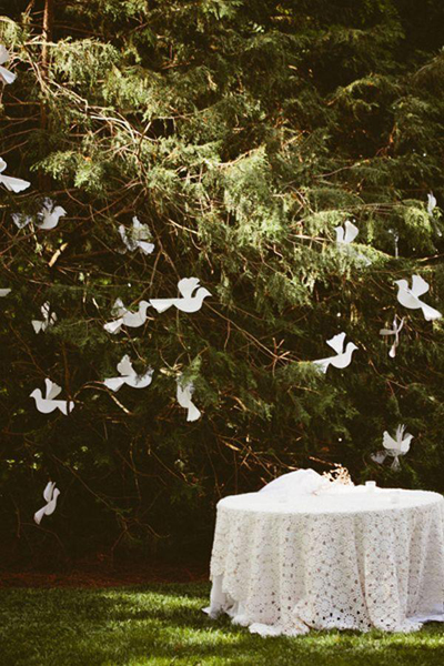 hanging paper doves in tree