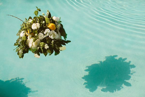 floating flower arrangement in pool