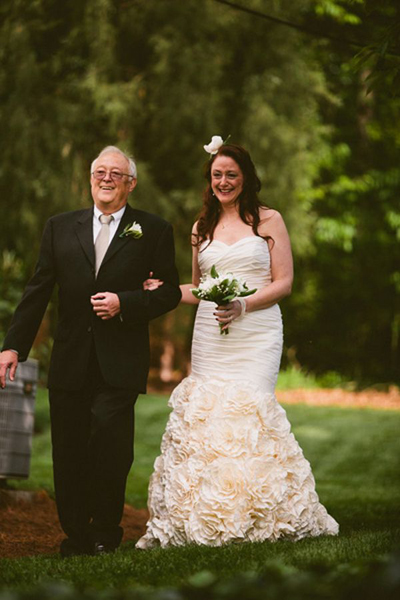 emotional bride walking down the aisle with her father