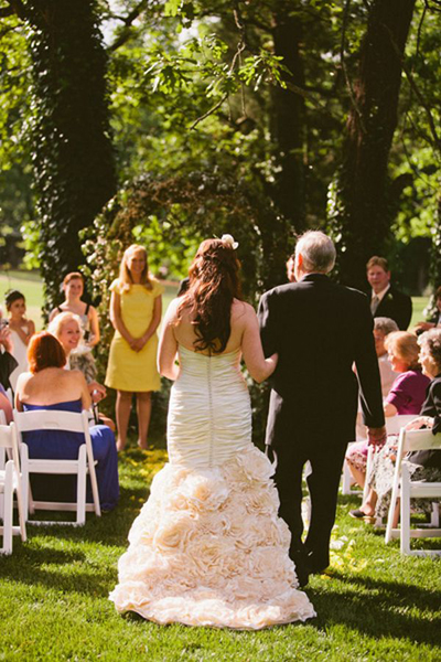 bride walking down aisle in ruffled gown