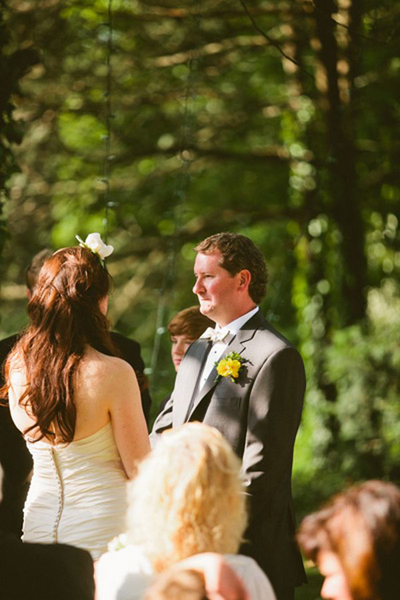 emotional groom at outdoor wedding ceremony