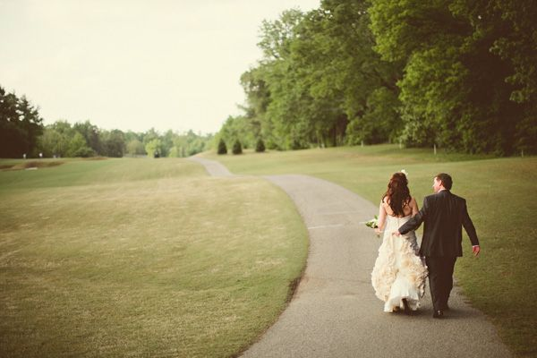 bride and groom walking on golf course