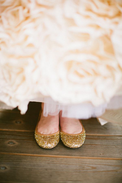 bride in gold glitter flats