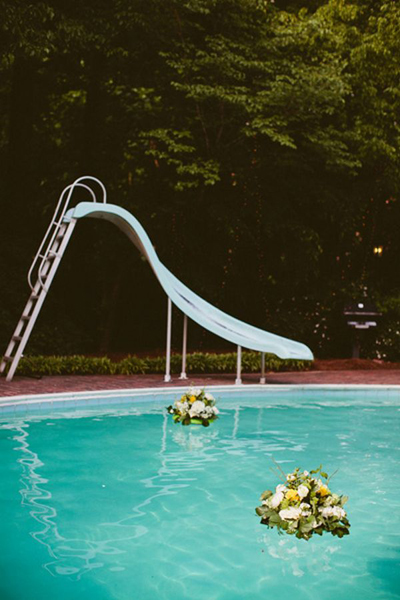 floating flower arrangements in pool