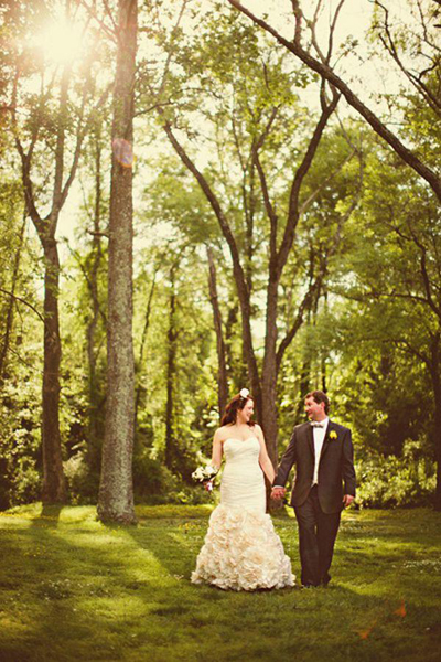 bride and groom walking amongst trees