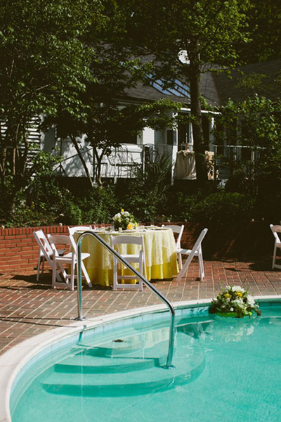 poolside reception with floating flower arrangements