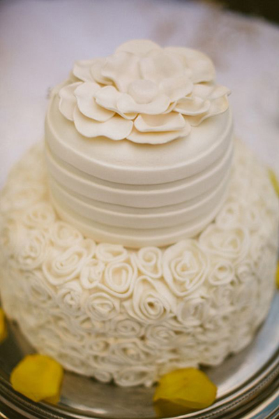 white wedding cake with white sugar gardenia