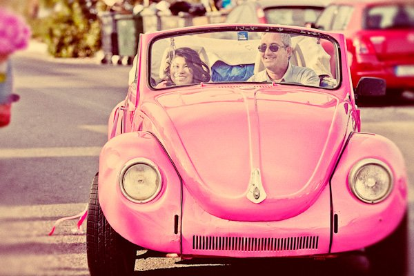 bride in pink volkswagen beetle