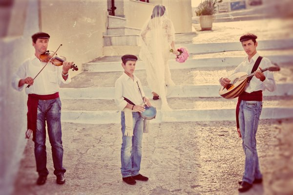 bride and greek musicians in Santorini