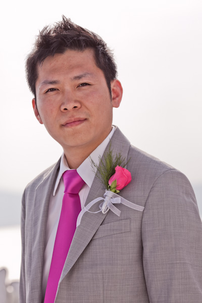groom in pink tie and pink rose boutonniere