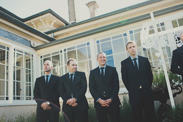 groomsmen lined up at outdoor wedding ceremony