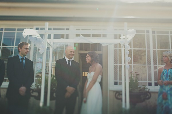 bride and groom in front of outdoor altar