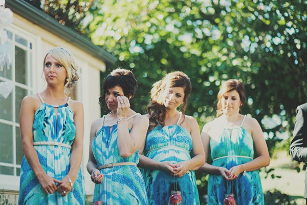 bridesmaids crying at wedding ceremony