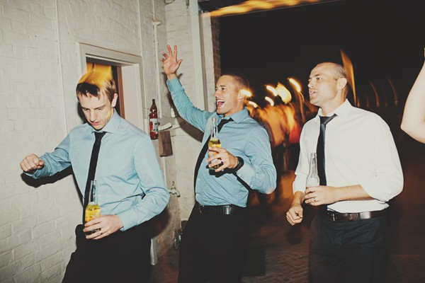 groomsmen dancing at reception