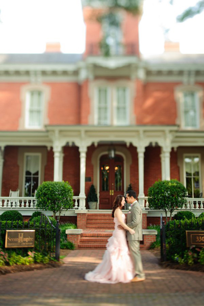 bride and groom outside North Carolina restaurant