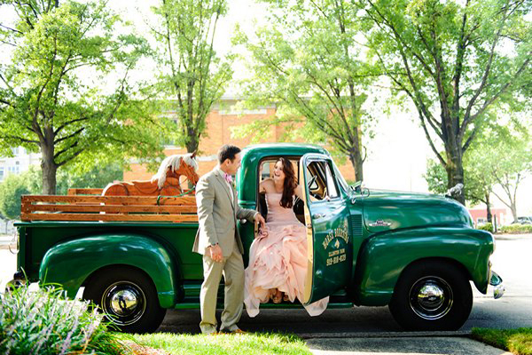 bride and groom in vintage green pick-up truck