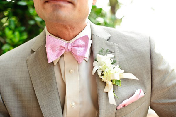 pink bow tie and stone colored suit