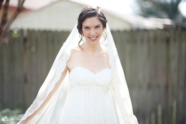 bride in lace trimmed veil