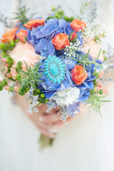 blue and coral wedding bouquet with turquoise brooch