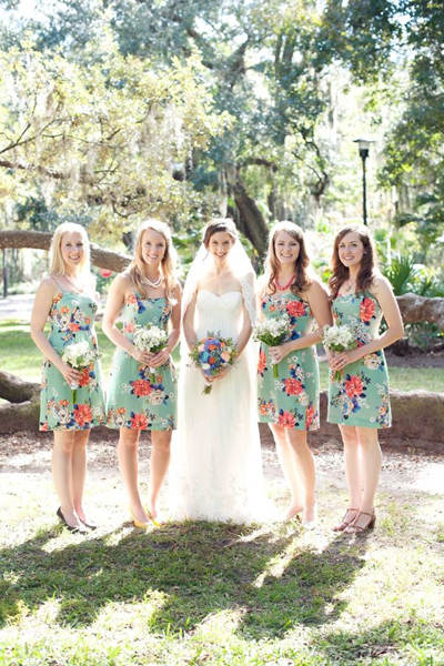 bride with bridesmaids in floral dresses