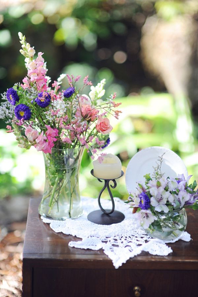 rustic flower arrangement and vintage wedding furniture
