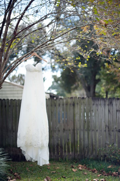 Watters wedding dress hanging on a tree