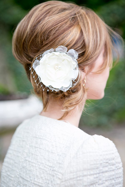 bride with fabric flower fascinator