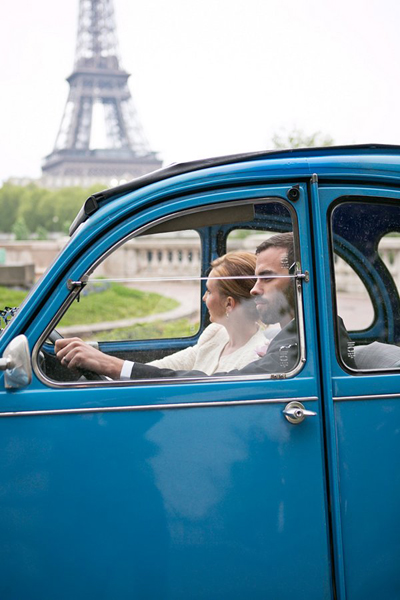bride and groom in vintage car in Paris