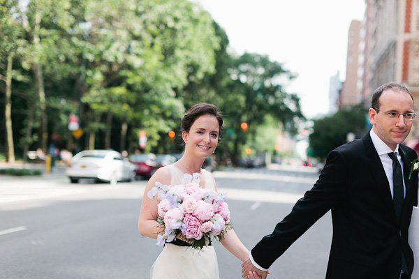 bride and groom crossing new york street