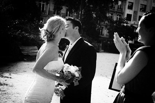 bride and groom first kiss in Paris