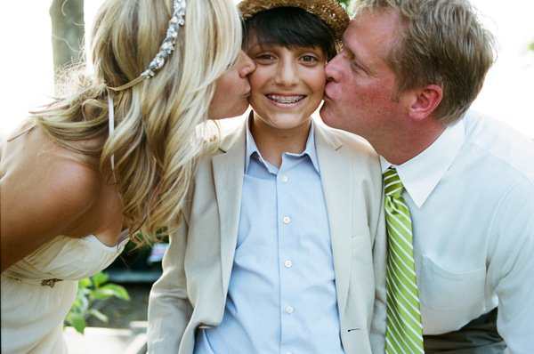 bride and groom kissing son