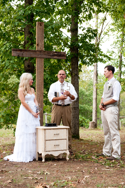 outdoor wooden cross at country wedding